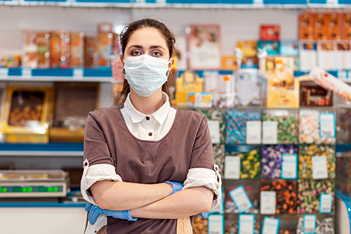 Small business owner wearing face mask